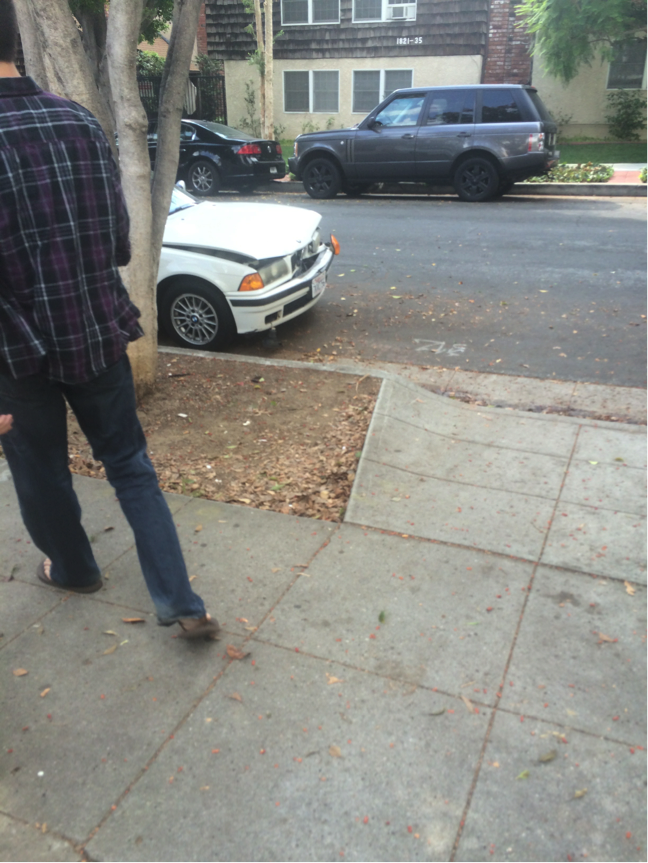 Geoff Lichtman parking across the street from property harrassing students